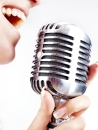Woman singing on retro microphone